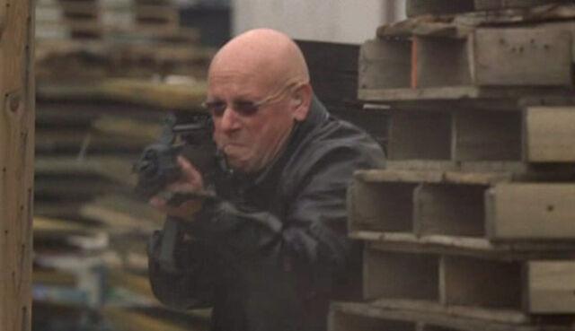 File:7x24- bald Alan Wilson mercenary.jpg