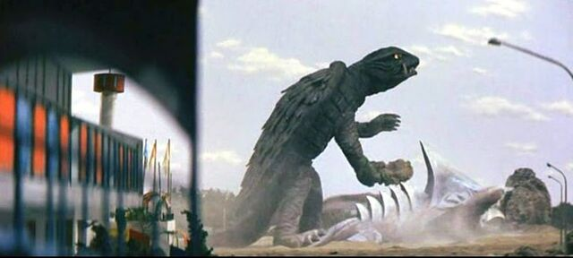 File:Gamera plays his theme tune on Zigra's spines..jpg