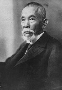 Tsuyoshi Inukai facing left