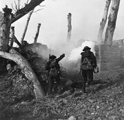 American soldiers advancing on a bunker