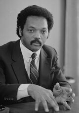 220px-Jesse Jackson, half-length portrait of Jackson seated at a table, July 1, 1983