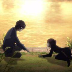 Kouichi helping Izumi.