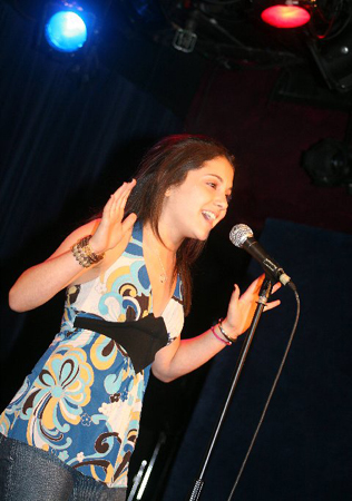 File:Ariana sings live.jpg
