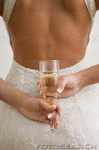 File:Woman holding glass of champagne.jpg