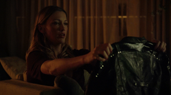 Laurel looks at Sara's jacket