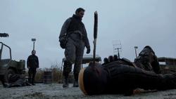 Slade Wilson stabs Billy Wintergreen in the eye