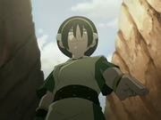 Toph pointing down