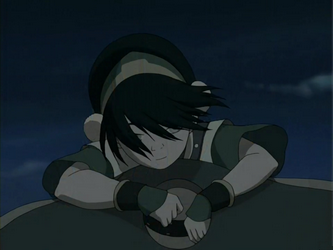 Calm Toph on Appa's saddle