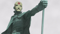 Aang's statue with Equalist mask.png