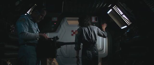 File:Ash holding a tracker.jpg