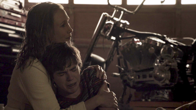 File:Norma holds norman.png