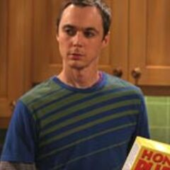 Sheldon with Honey Puffs in his hand.