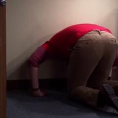Sheldon's head is stuck in the wall.
