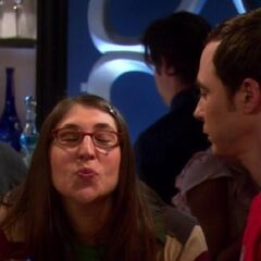 Amy puckers up so that Sheldon can experiment kissing with her.