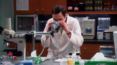 Sheldon looking through the microscope
