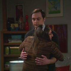 Amy hugs Sheldon.
