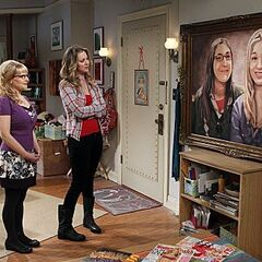Penny and Bernadette look at the painting.