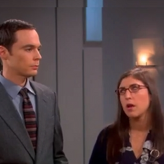 Amy coaching Sheldon.