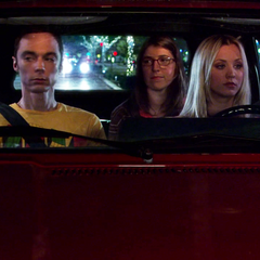 Penny driving Amy & Sheldon on their first date.