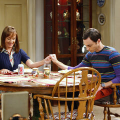 Sheldon praying at home with his mother.