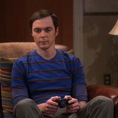 Sheldon playing a video game.