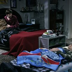 Sheldon sleeping over at Howard's.