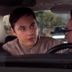 Sheldon hiding in Leonard's car to get into work.