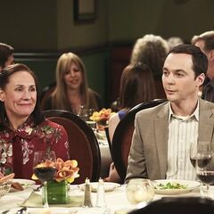 Mary is having a good time. Sheldon is oblivious.