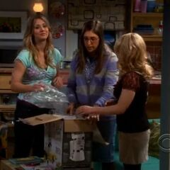 Leonard spots Penny and the girls in her apartment.