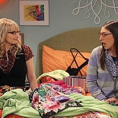 Amy and Bernadette have a talk on Penny's bed.