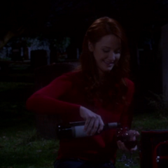 Emily poring their wine.
