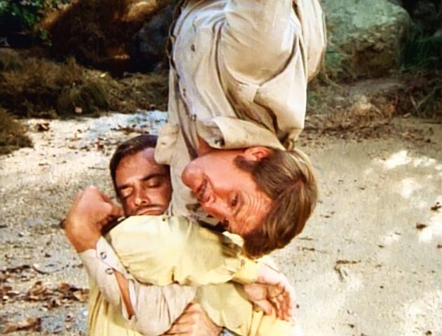 File:The Most Dangerous Enemy - Steve saving Rudy trapped in quicksand.jpg