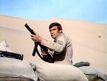 The Moon and the Desert - Steve firing a gun