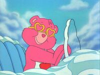Love-a-Lot Bear in a cloud mobile and sunglasses