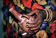 Sudan Culture Woman with Jabana.jpg
