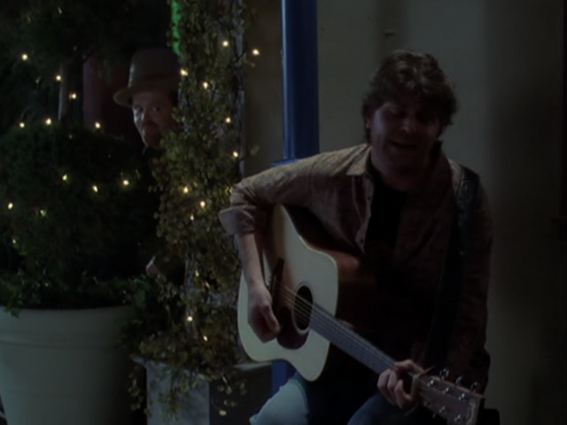 File:5x17StreetPerformerPlaying.png