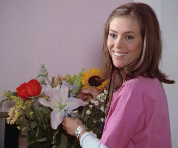 File:2x07-phoebe-arranging-flowers.jpg
