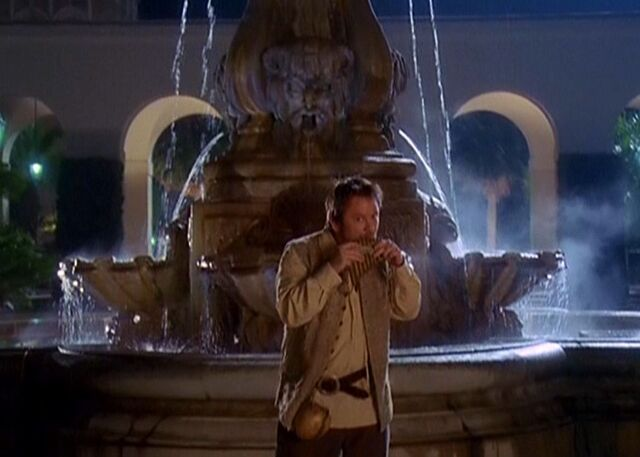 File:Tull playing flute in front of fountain.JPG
