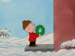 Charlie Brown trying to sell a wreath