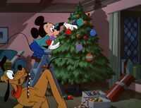 Mickey decorating his tree