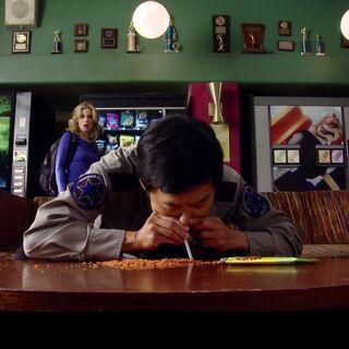 Chang snorts a bag of corn chips.