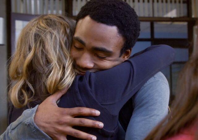 File:Troy hugs Britta.jpg