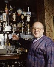 Roy alec behind the bar