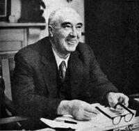 Harry Pollitt at desk