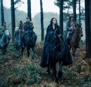 Diana Prince and company riding on horses