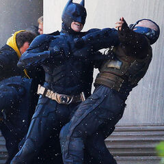 Christian Bale and Tom Hardy as Batman and Bane fighting on set.