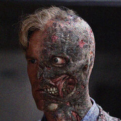 Concept art of Aaron Eckhart as Two Face.