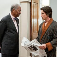 Lucius and Bruce in <i>The Dark Knight Rises</i>.