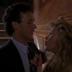 Vicki pulls Bruce closer.