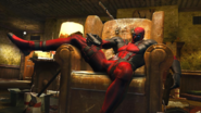 Marvel Comics - Deadpool sitting on his chair while watching TV